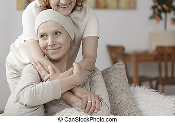 Family member supporting sick woman