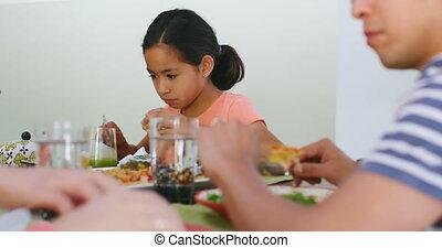 Family members having breakfast on dining table 4k - Family ...