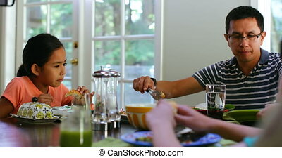 Family members having breakfast on dining table 4k