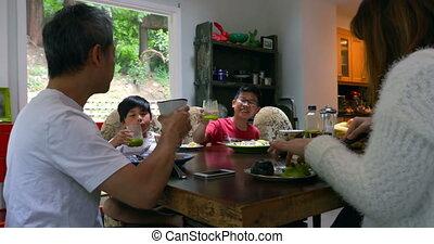 Family members having juice on dining table 4k - Family ...