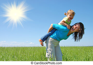 family mother and child under blue sky