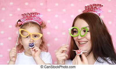 Family - mother and daughter play together, laugh and dress...