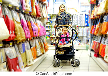 family mother baby son supermarket stroller