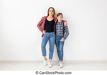 Family, mothers day and teenager concept - Portrait of mother and son on white background