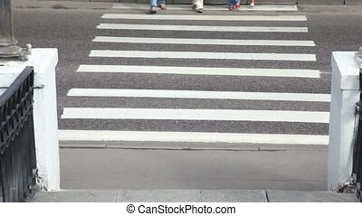 Family moves at crosswalk, parents keep childrens hands,...