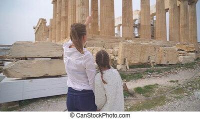 Family near ancient Parthenon in the Athenian Acropolis.