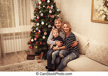Family near Christmas Tree