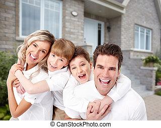 Family near new house.