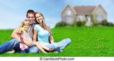 Family near new house. - Happy Family near new home....