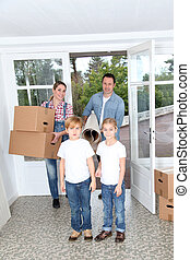 Family of 4 people moving in new home