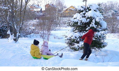 Family of dad and kids vacation on Christmas eve outdoors