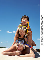 Family of divers - Portrait of happy family in goggles and ...