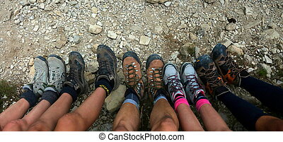 family of five people with climbing boots in mountain