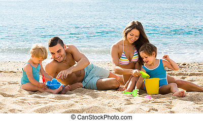 Family of four at the beach