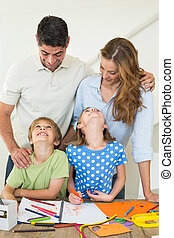 Family of four coloring at home