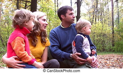 family of four. Faces looking at something