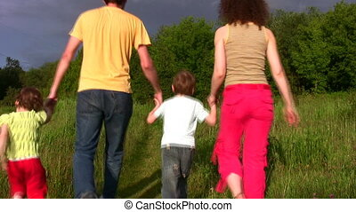 family of four in park