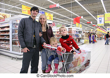 family of four in shop