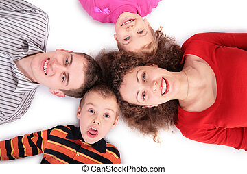 family of four lying on floor