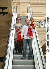 family of four on escalator
