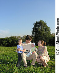 Family of four on grass w