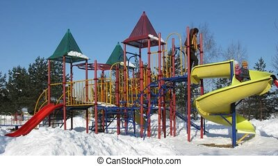 family of four on winter playground , time lapse