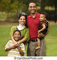 Family of four - Portrait of happy smiling family of four in...