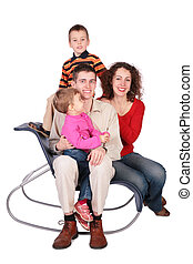 Family of four sits on chair