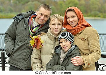 Family of four sitting