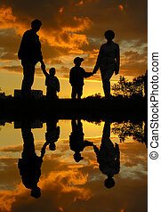 family of four sunset 2 and water
