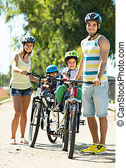 Family of four traveling by bicycles