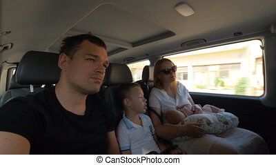 Family of four traveling by car in the city