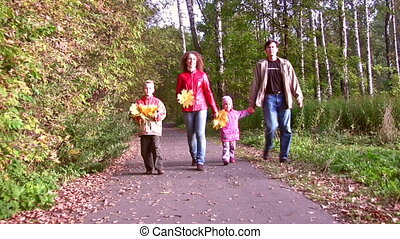 family of four walking in autumn park