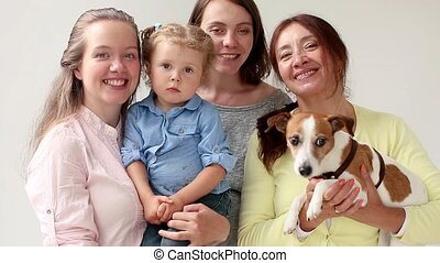 Family of four women and dog smile and laugh - Family of...