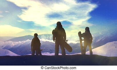 Family of snowboarders on top of the mountain.