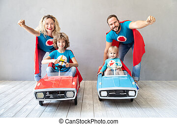 Family of superheroes playing at home