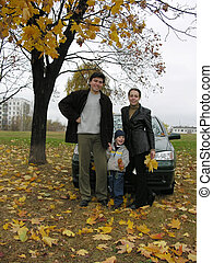 family of three and car