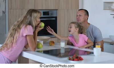Family of three enjoying breakfast together