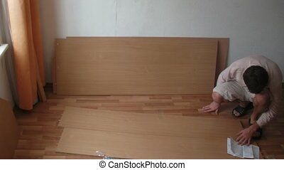 Family of three: father with two children constructs case. Time lapse.