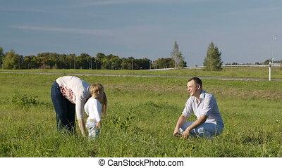 Family of three having fun outdoors.