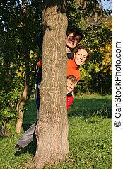 family of three hide tree