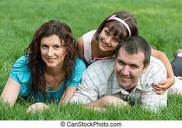 Family of three on the grass