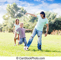 Family of three playing with  ball