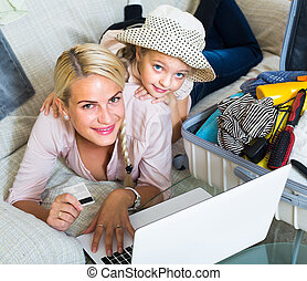 Family of two buying tickets online.