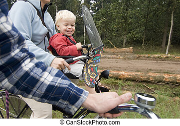 Family on a bike ride - A family on a bike ride, with a ...