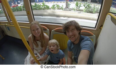 Family on a bus. concept of using public transport.