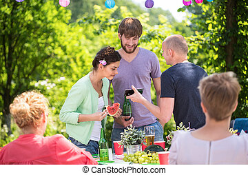 Family on a garden party - Family spending time together on...