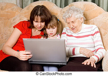 Family on a sofa with computer