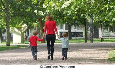 Family on a Walk in Summer. Child with mother Together. Slow motion