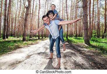 Family on a walk in the woods